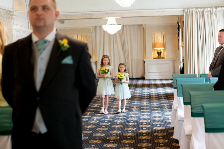 Flower girls walking down the aisle at Bartle hall