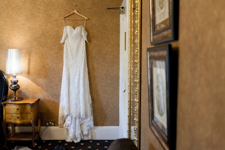 Wedding dress hanging on wall at Liverpool Sefton Park Sure Hotel