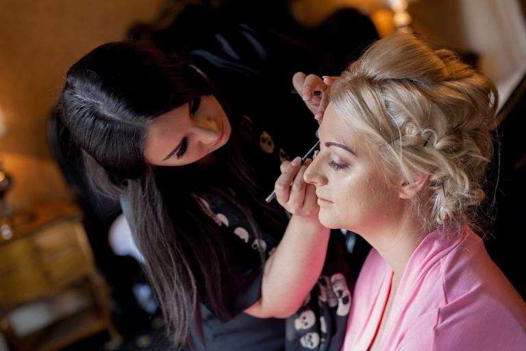 Make up artist putting eyeliner on brides maid at Sefton Park sure hotel