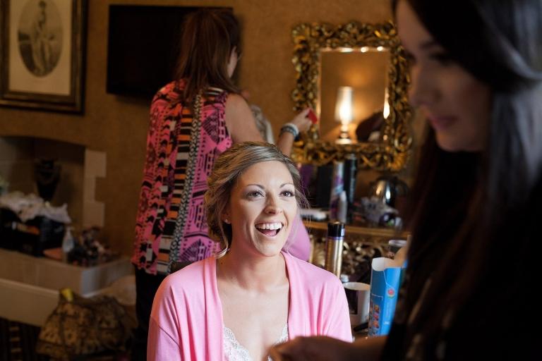 Bride laughing during wedding prep Liverpool Sefton Park Sure Hotel