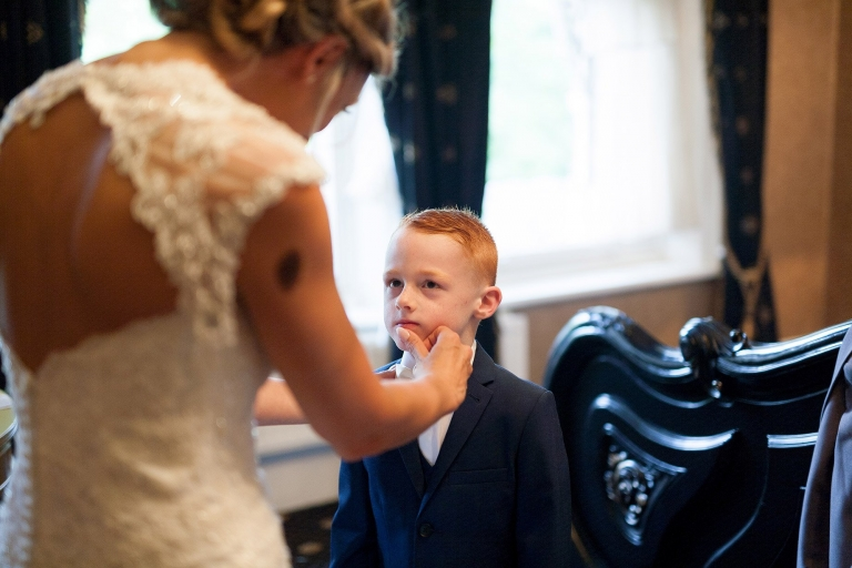 Bride cleaning Paige boys face at  Liverpool Sefton Park Sure Hotel