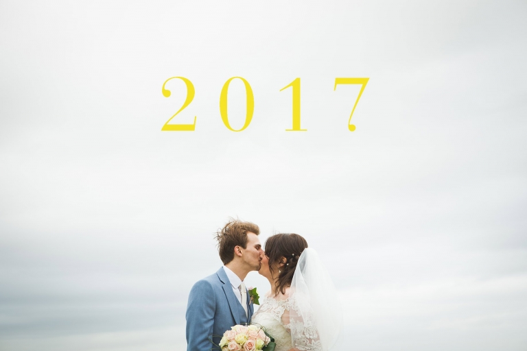 Bride and groom kissing with sky in background. 2017 best of Lanncashire wedding photographer