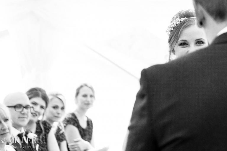 brides eyes looking over grooms shoulder at rivington's spring cottage