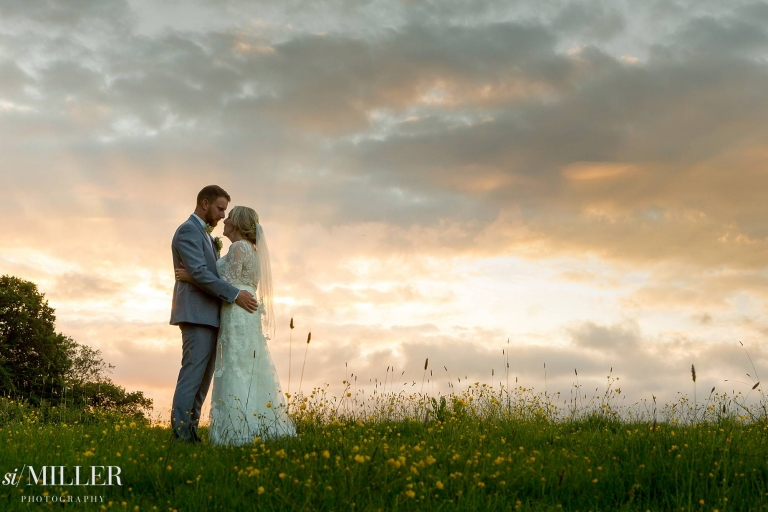 wedding couple with sunset behind at Ferraris country Hotel