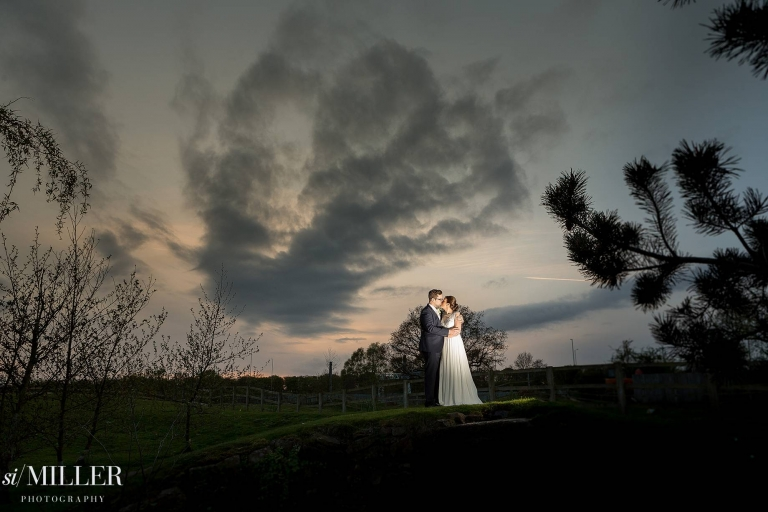 bride and groom kissing light by flash at Charnock Farm