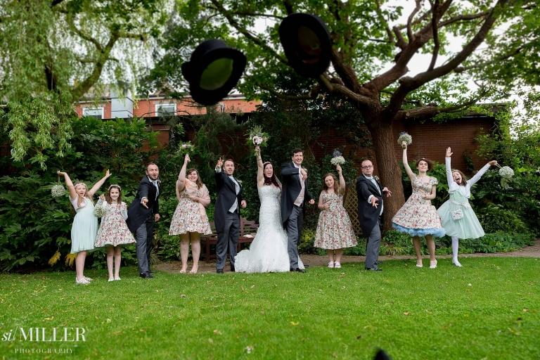 bridal party throwing top hats towards camera at barton grange hotel Preston