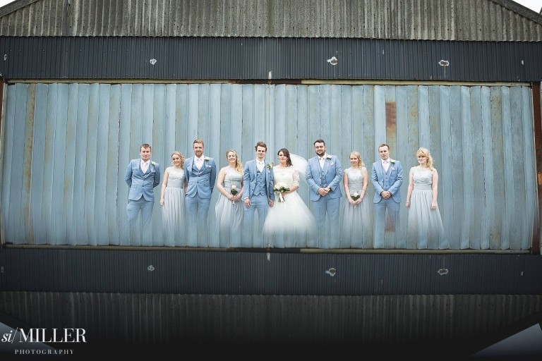 bridal party in front of barn at Beeston Manor Preston