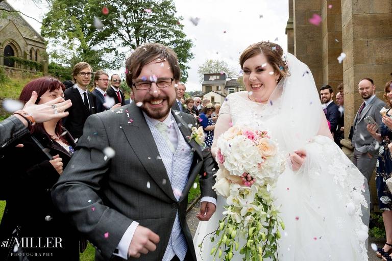 newly weds walking through confetti accrington