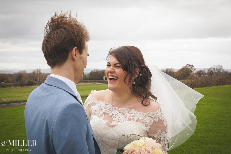 bride laughing at groom at Beeston Manor