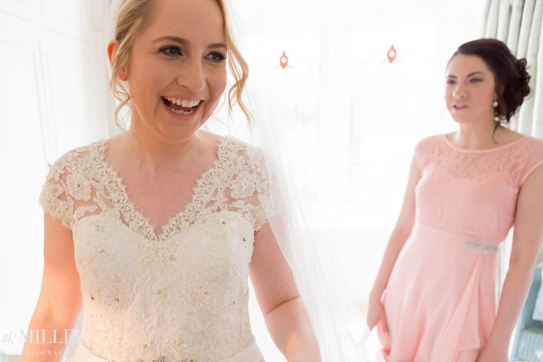 bride smiling in her wedding dress at home in Lytham St Annes.