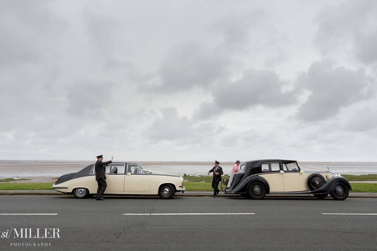 wedding cars parked with sea behind them at lytham st. annes