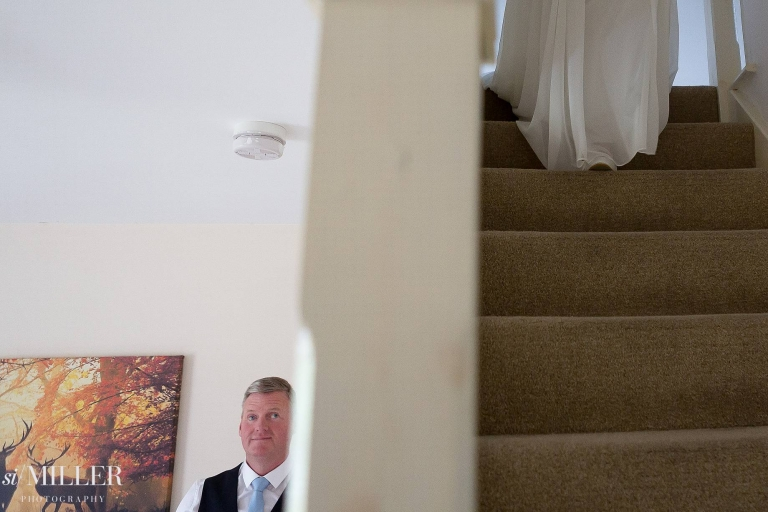 brides feet on stair as she walks downstairs for fathers first look