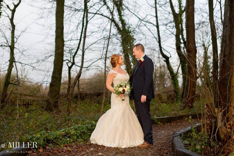 Couple with golden winter light on them at the villa wrea green garden