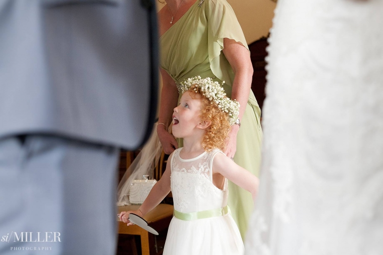 flower girl gasping in amazement at Ferraris country Hotel