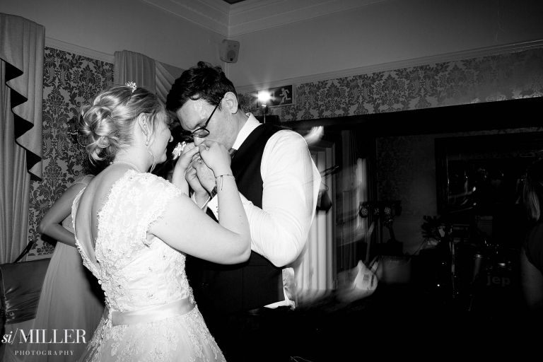 groom kissing brides hands on the dance floor at Bartle Hall Preston.