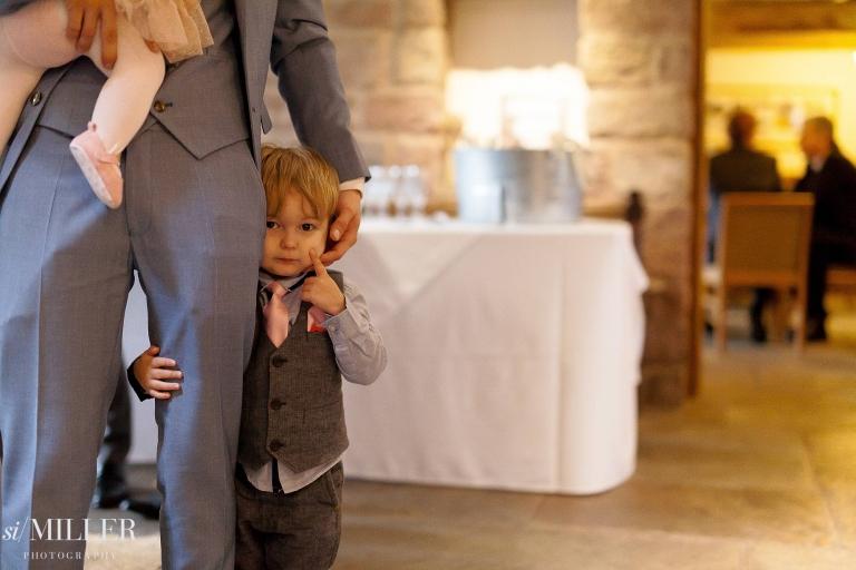 Boy holding dads leg at beeston Manor.