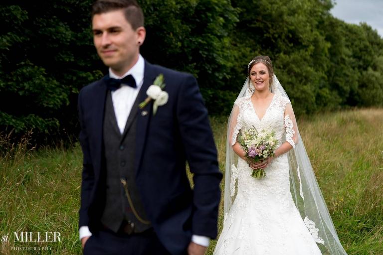 groom walking away from groom at rivington spring cottage wedding
