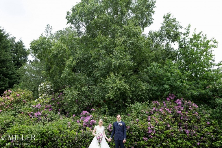 couple in front of purple rhododendron at Bartle Hall