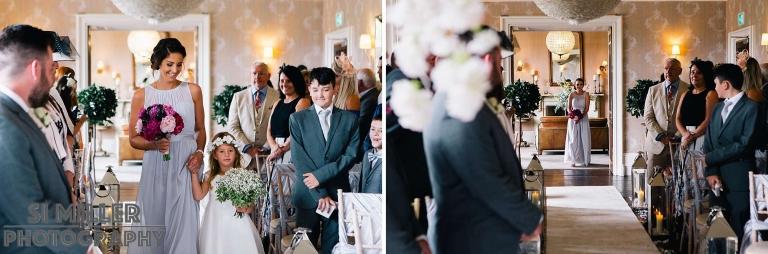 Bridesmaids walking down the aisle at Falcon Manor