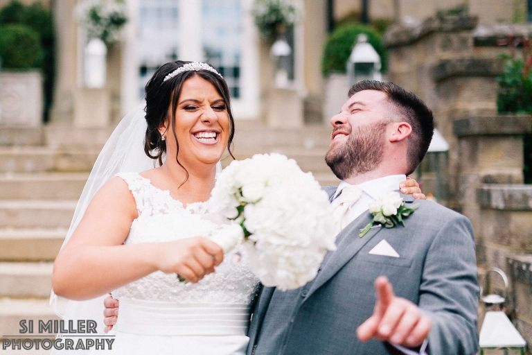 bride and groom having a laugh during wedding portraits