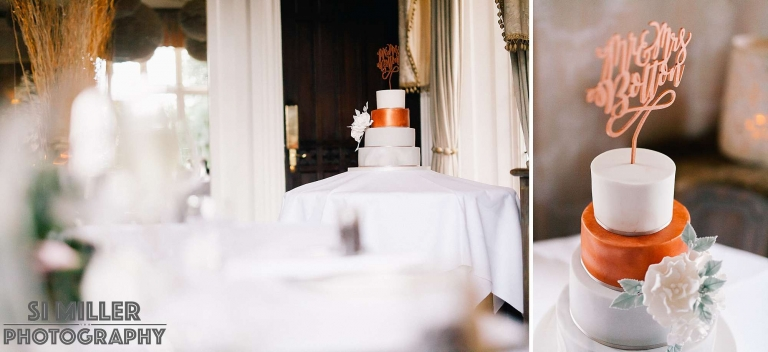 wedding cake with orange tier and mr and mrs topper