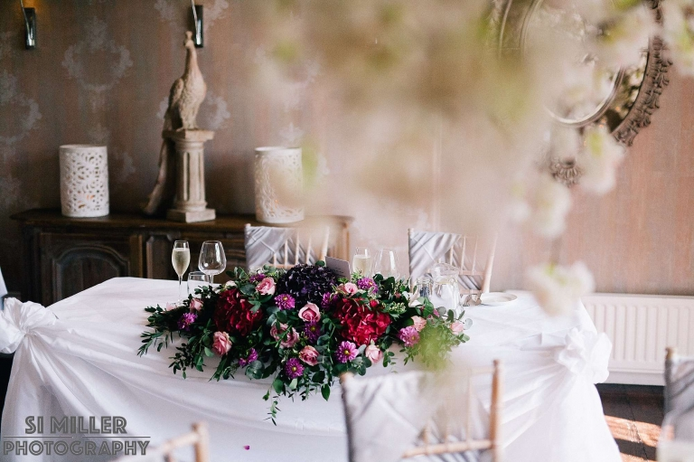 top table with pink flowers