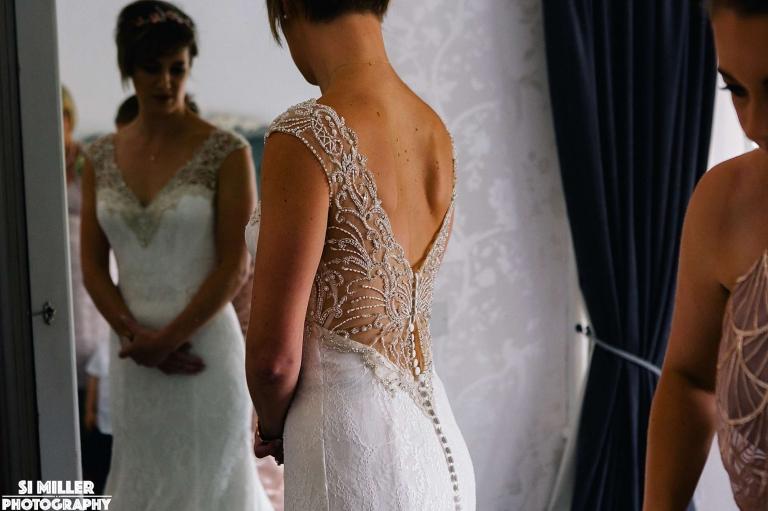 bride getting in wedding dress Stirk House wedding photographer lancashire