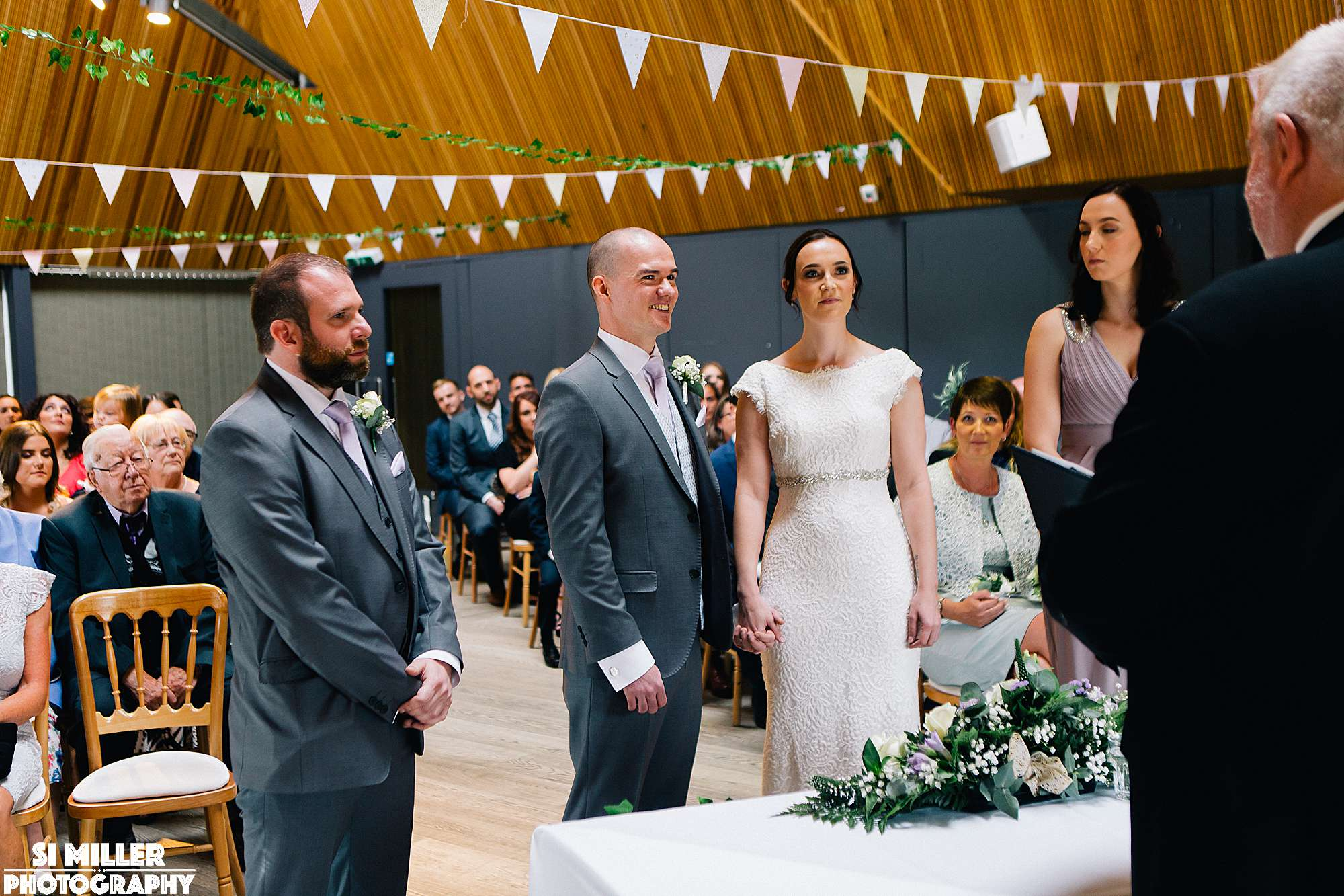 bride and groom at the alter at brockholes with witnesses