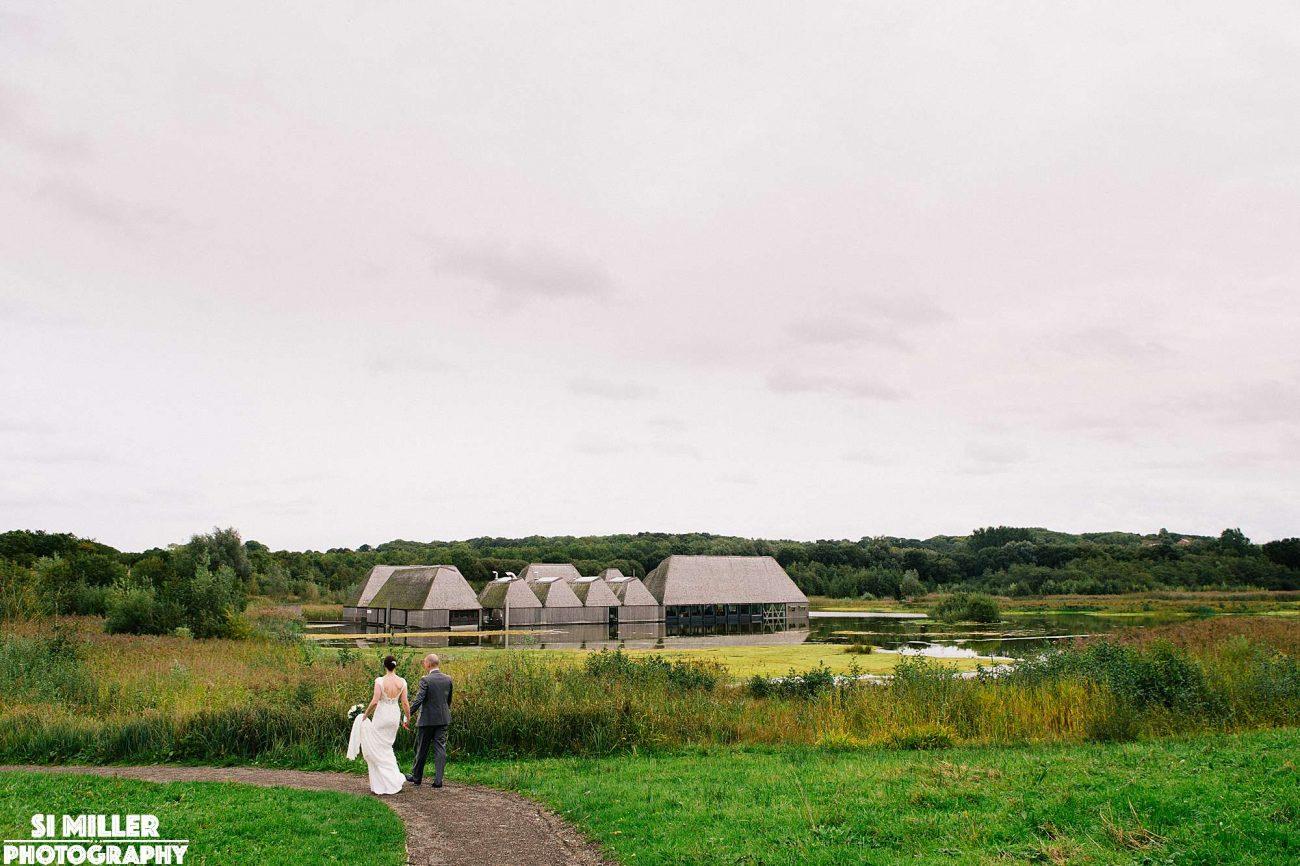 Bride and groom walking back to brockholes