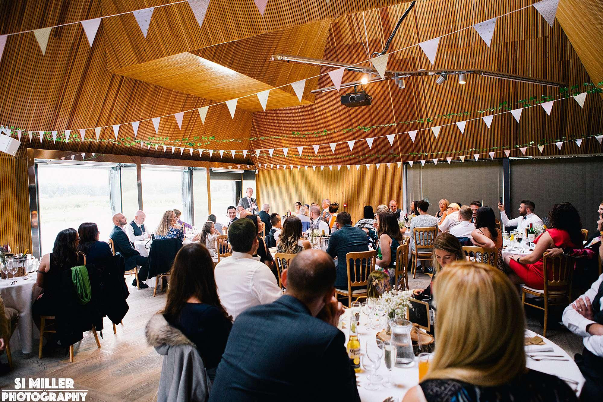Groom saying his speech during wedding breakfast infront of wedding guests at brockholes