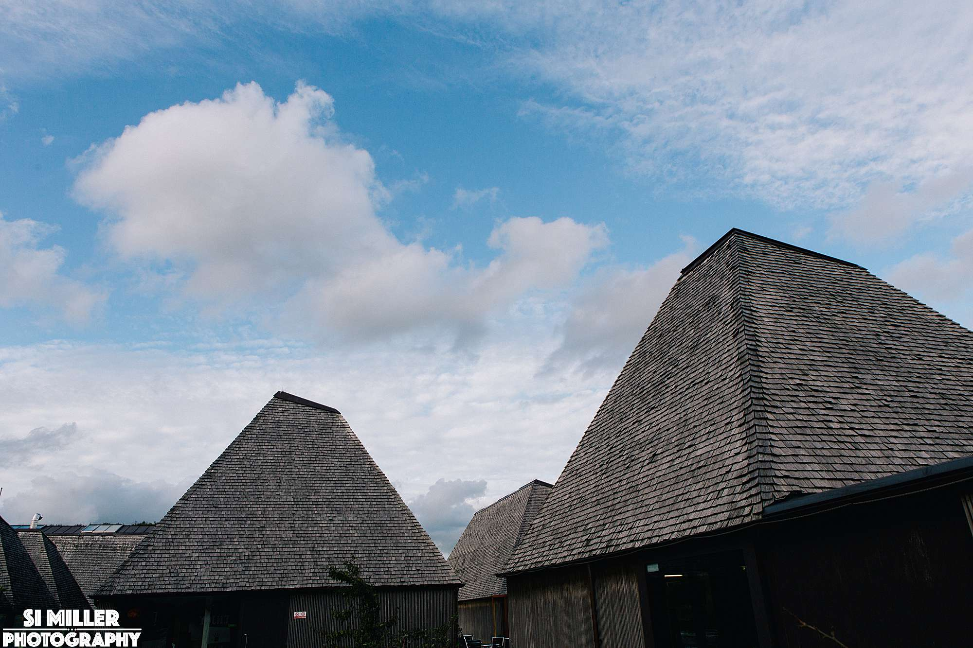Roofs of brockholes buildings that are environmental friendly with sky and clouds