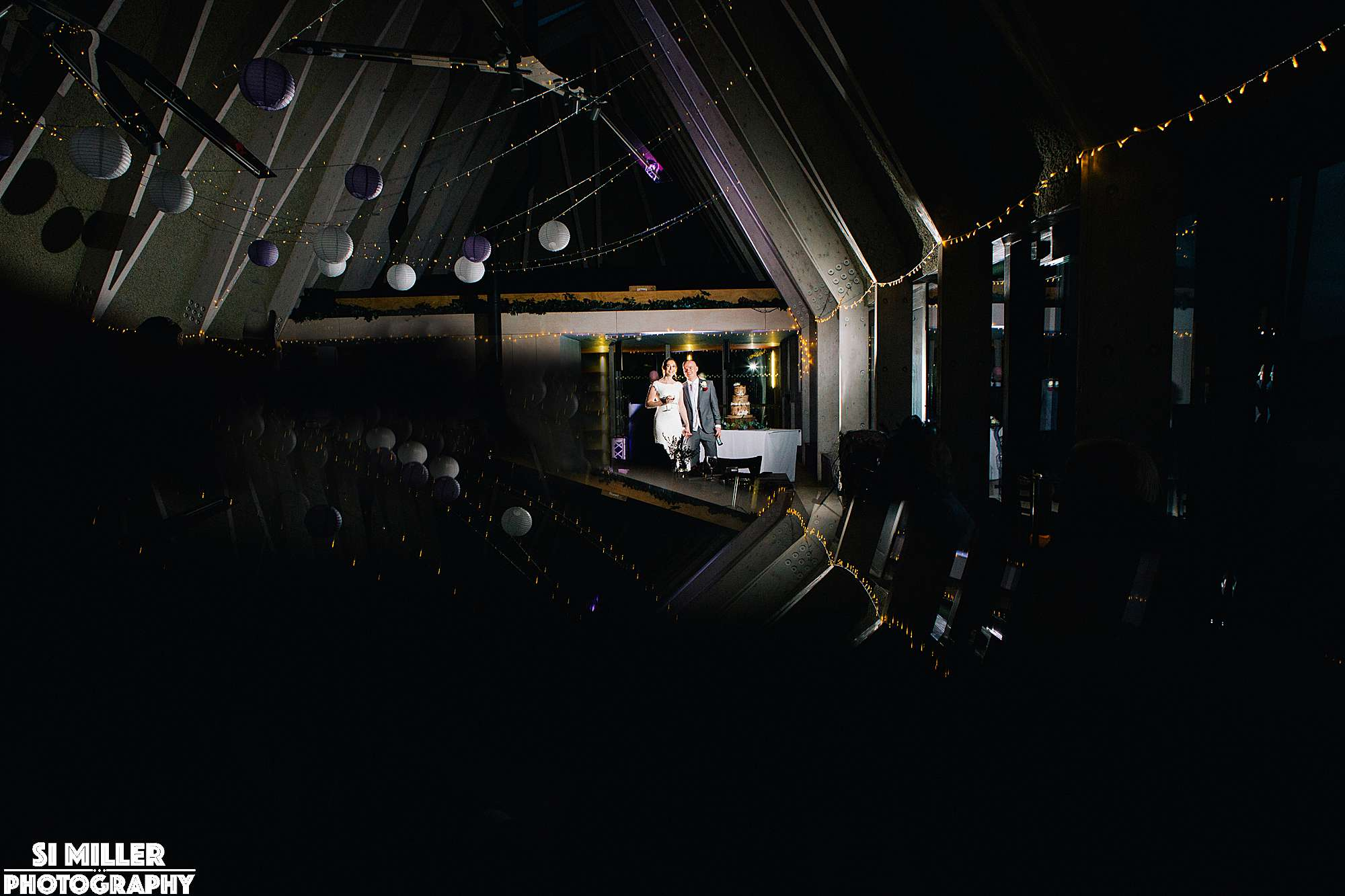 Bride and groom light by flash at brockholes restaurant
