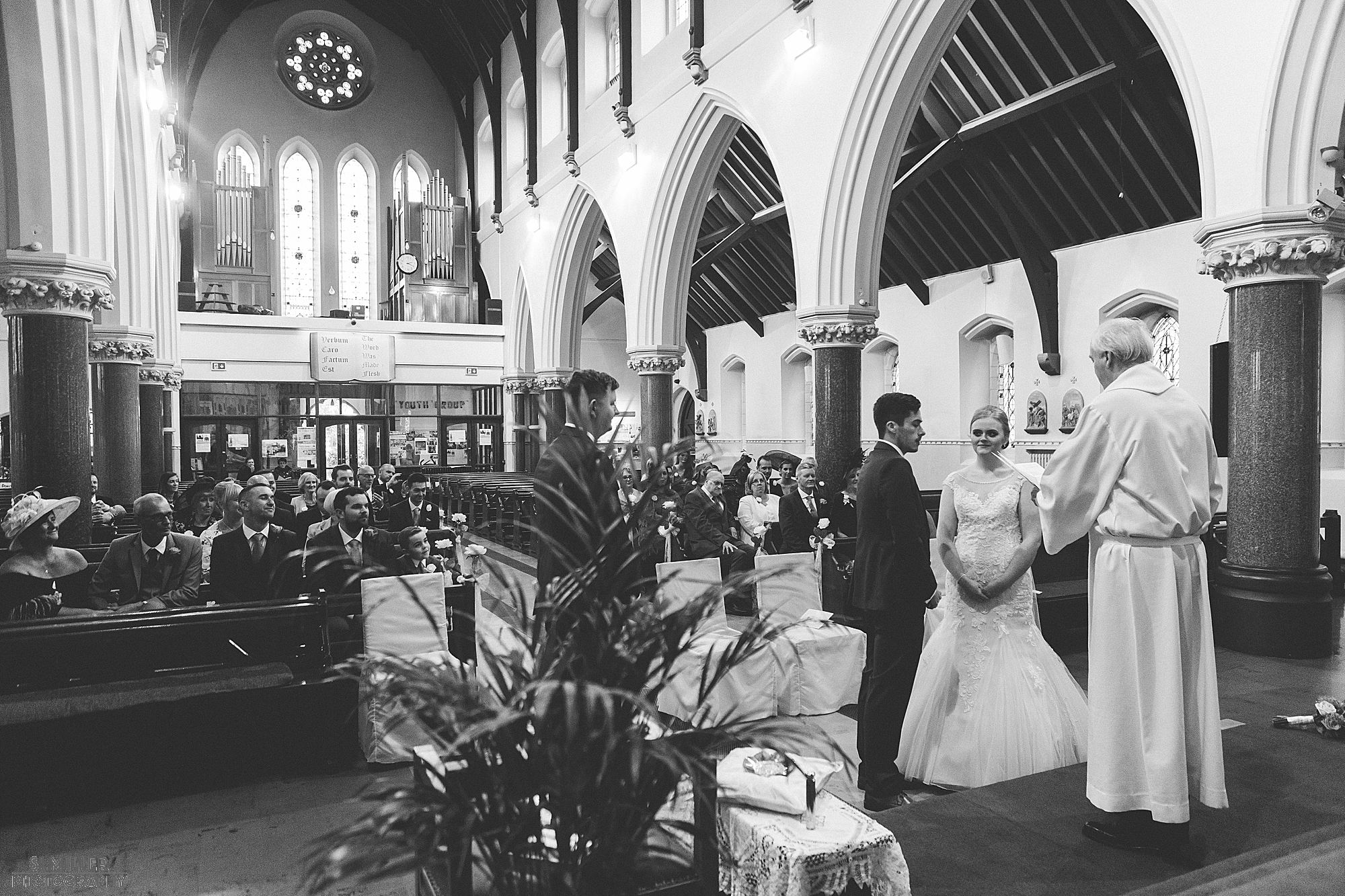priest conducting wedding ceremony Blessed Sacred Church Liverpool