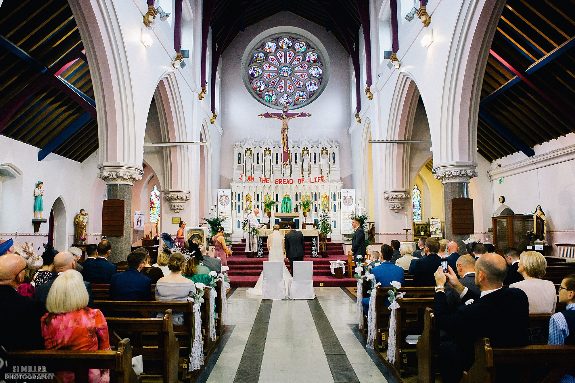 bride and groom at alter during wedding ceremony at Blessed Sacred Church Liverpool