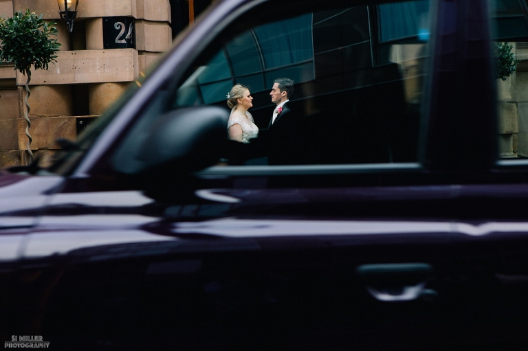 bride and groom through a moving taxi at Richmond Hotel liverpool