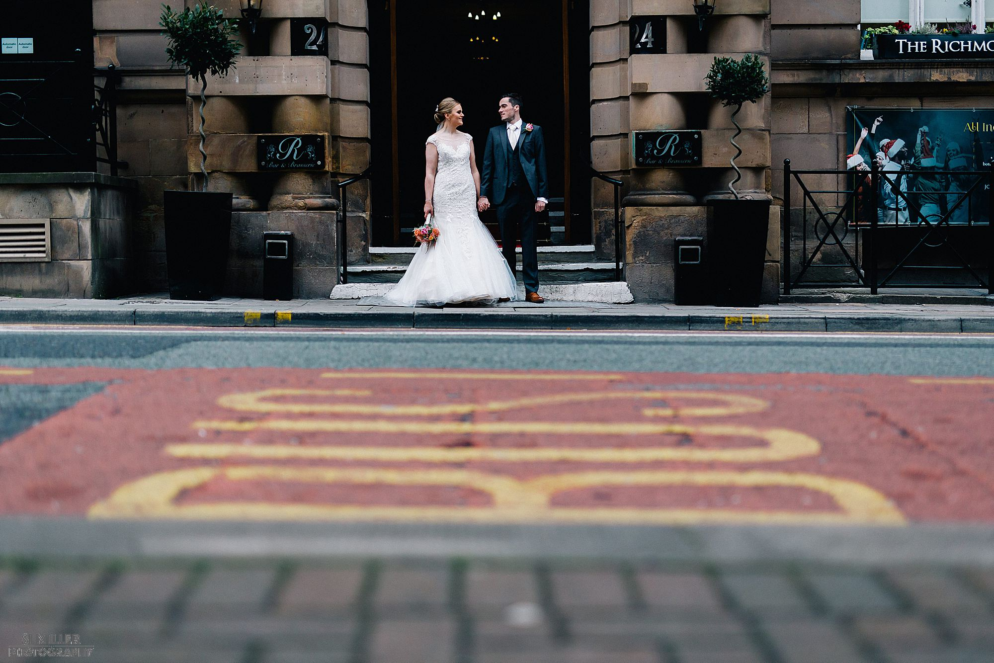 Bride and groom outside the Richmond Liverpool couple portrait