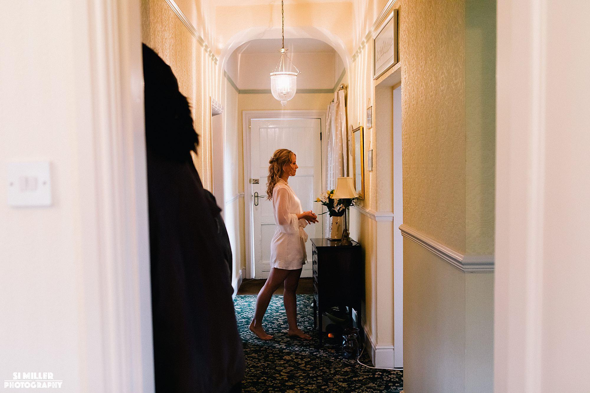 bride looking in the mirror at home in Preston