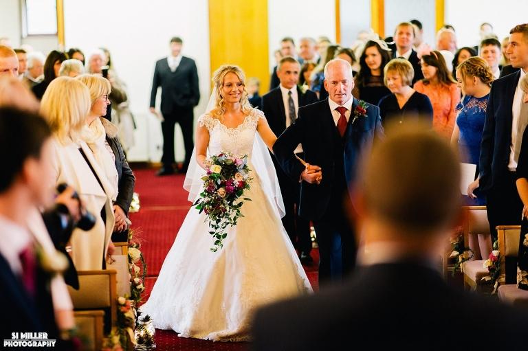 Father walking daughter down the aisle at crown lane free methodist wedding photographer preston
