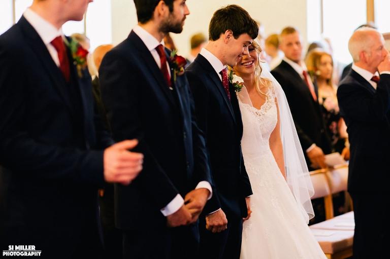 Bride whispering to groom crown lane free methodist preston