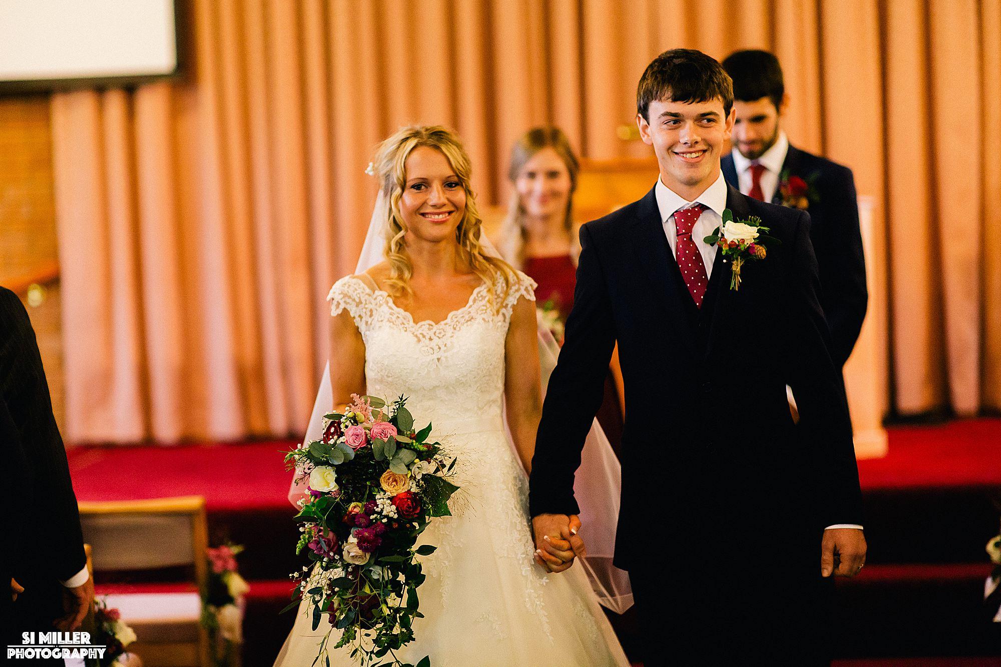Bride and groom walking down the aisle crown lane free methodist