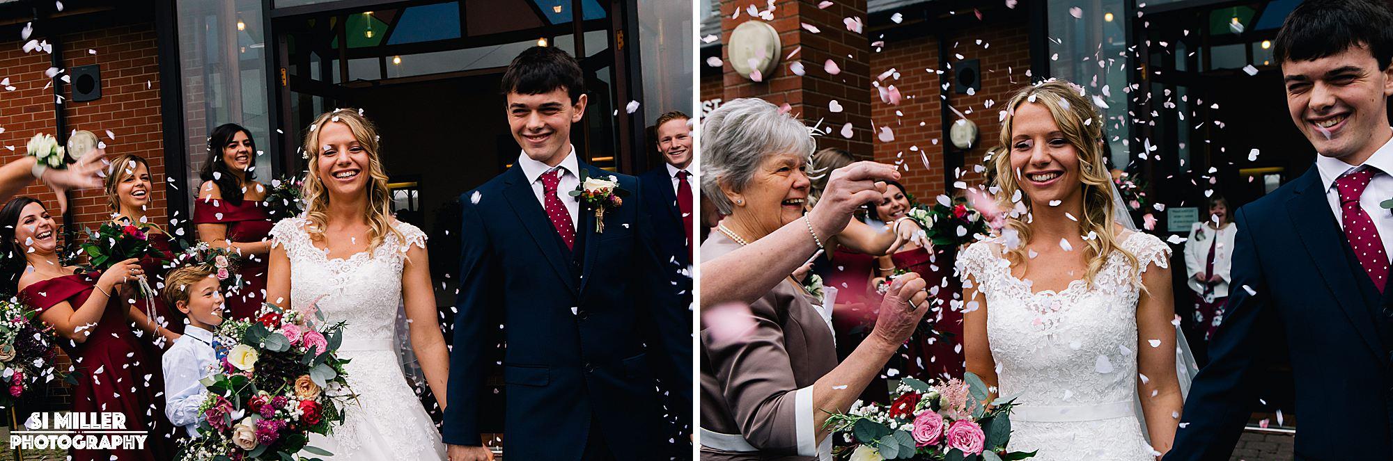Confetti being thrown over bride and groom crown lane free methodist wedding photographer preston