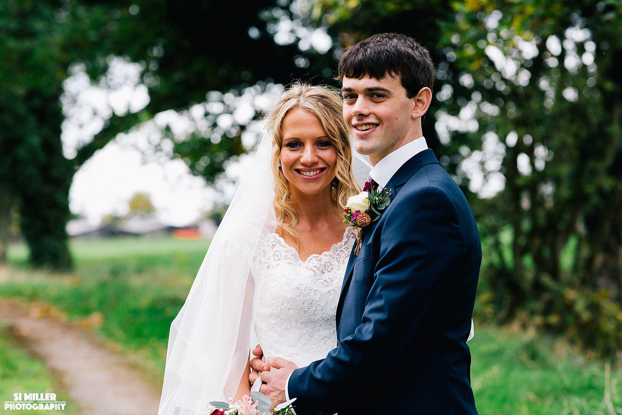 Bride and groom portrait smiling