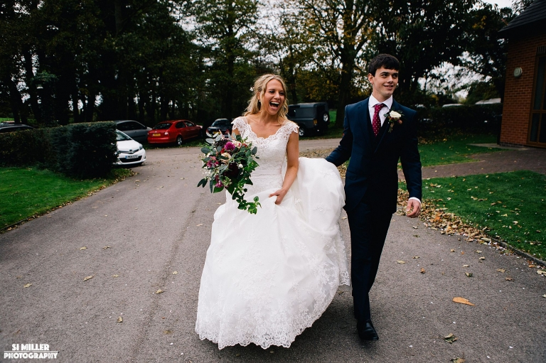 Wedding couple walking and laughing