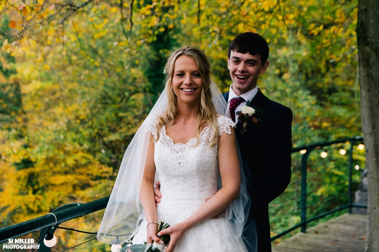 Bride and groom on terrace at inn at whitewell