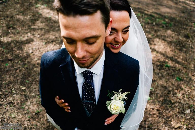 Bride hugging groom in blue suit