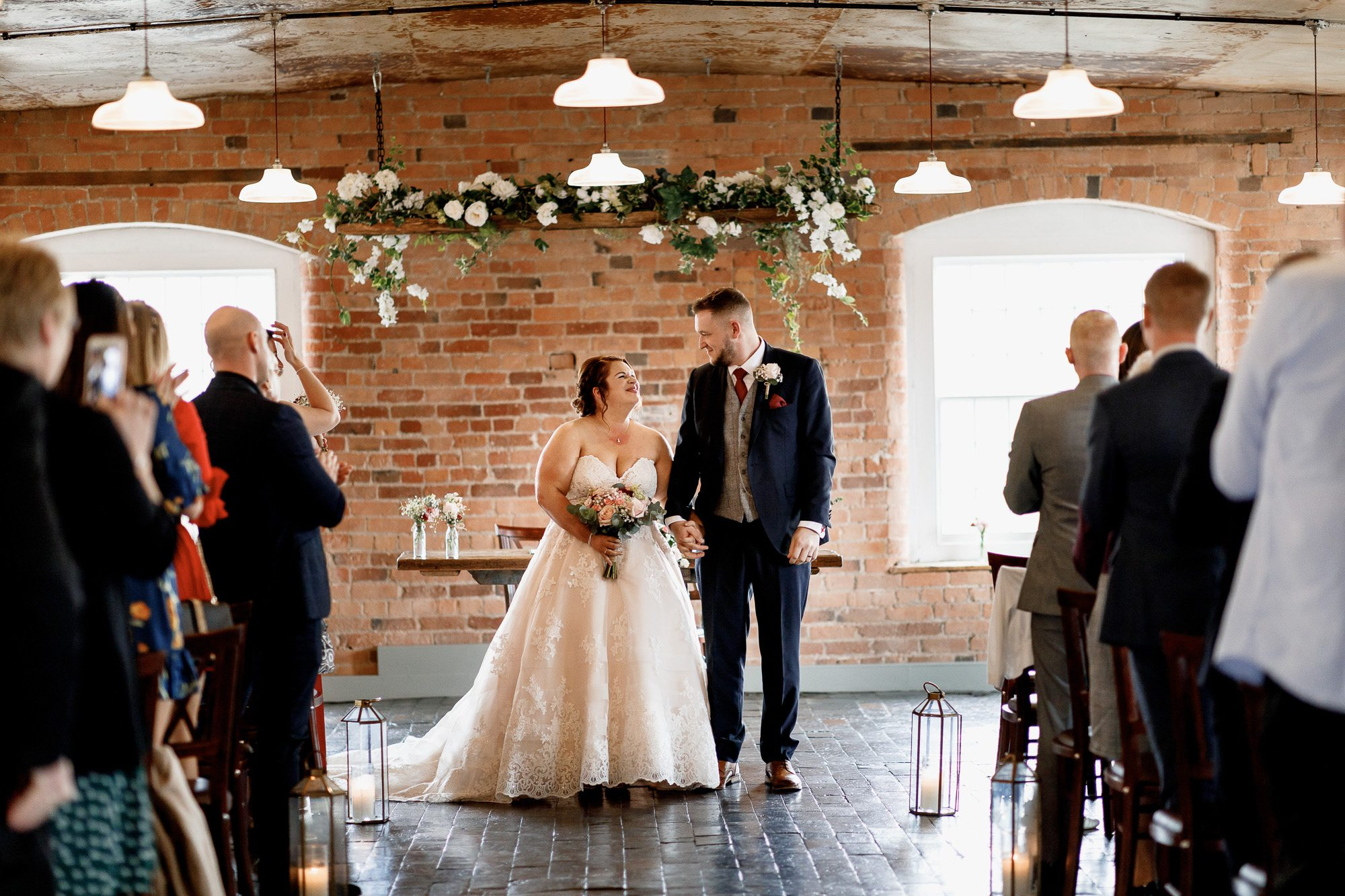 Bride and groom getting married at The West Mill