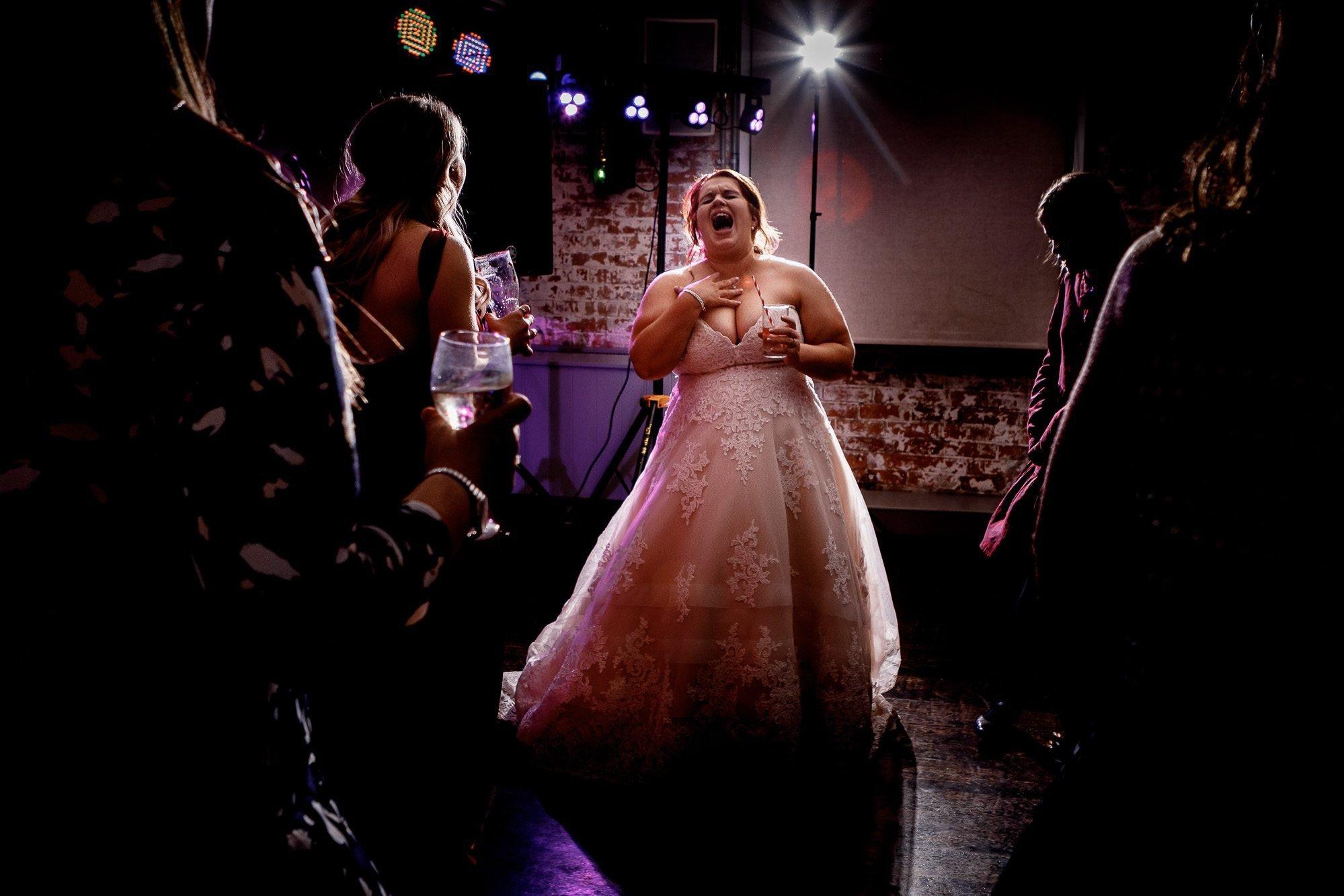 Bride singing on dance floor at west Mill