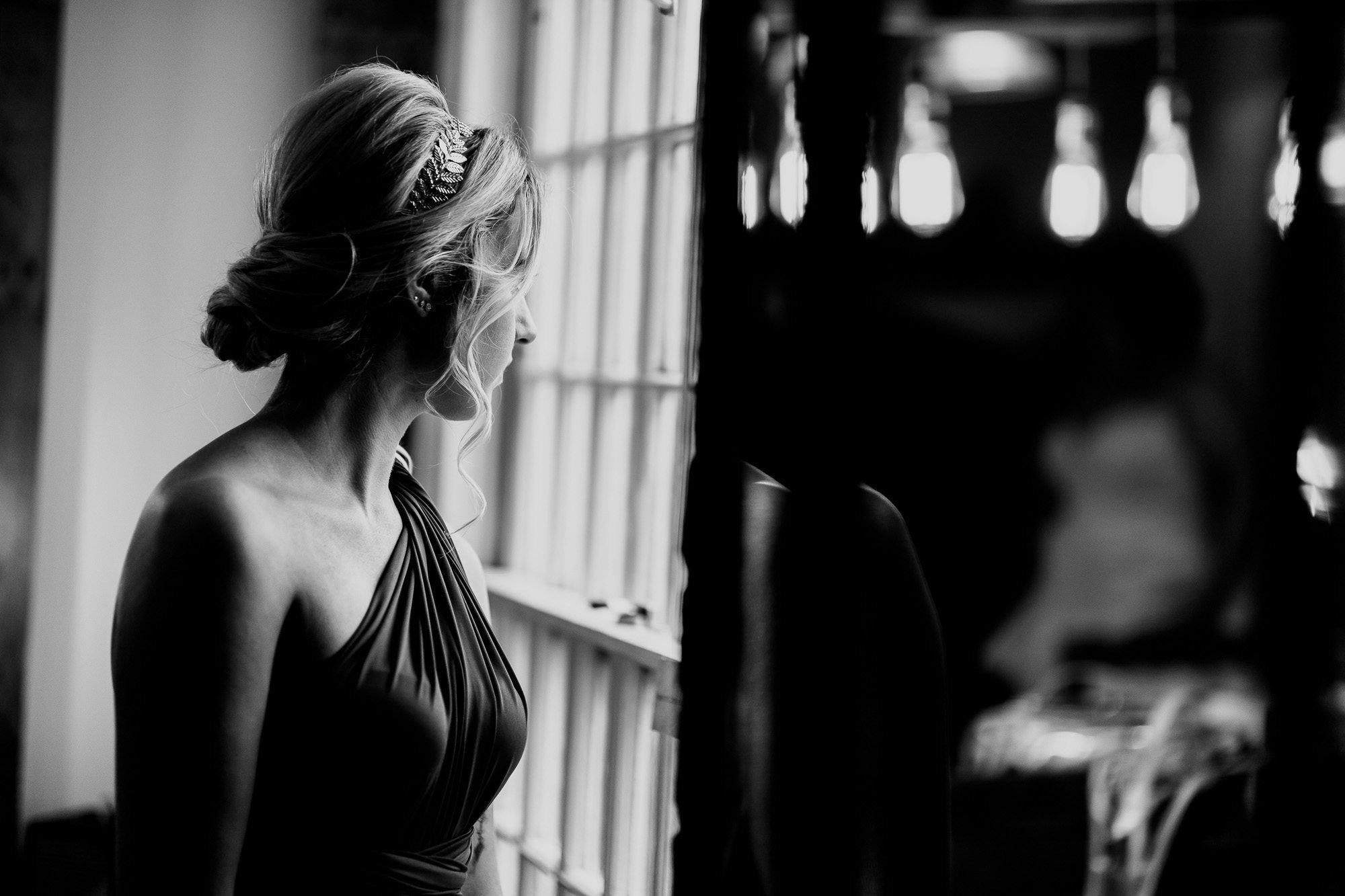 Bridesmaid in window