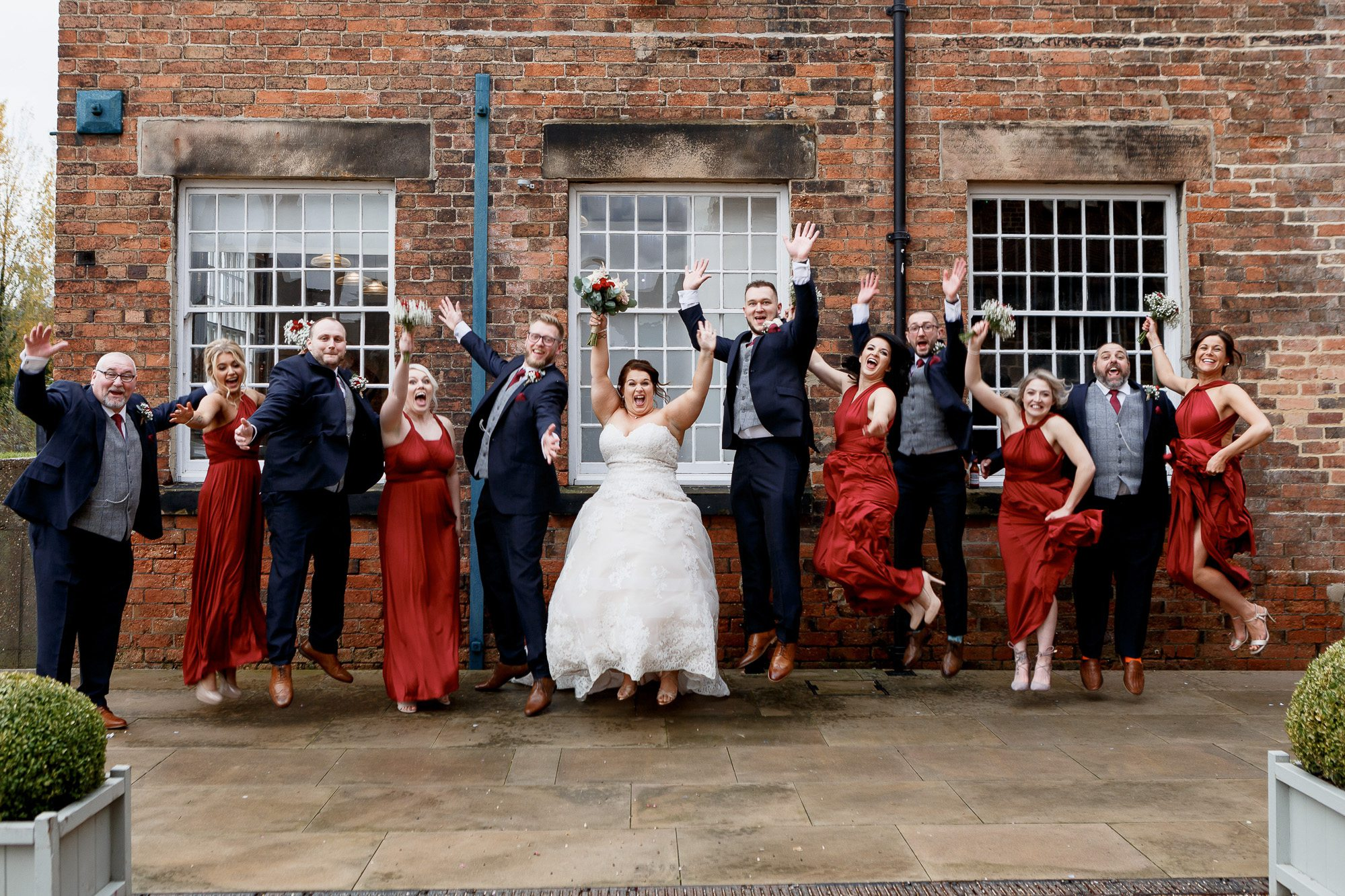 Bridal party portrait jumping at west Imill
