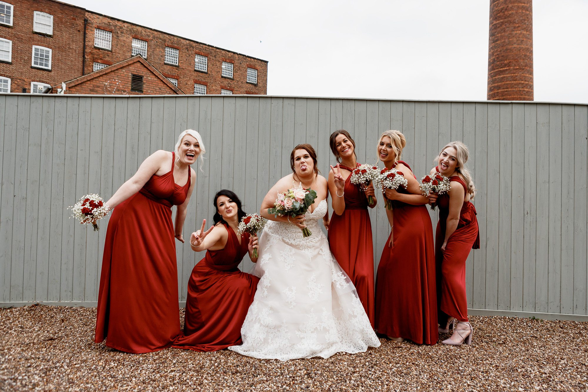 Bride and bridesmaids photo outside west mill